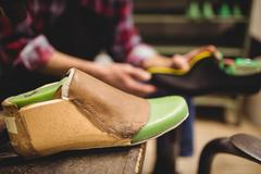 Focus on foreground of a pattern of shoes in the retail Stock Photos