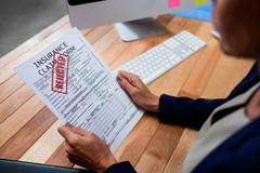 People reading an insurance claim form Stock Photos