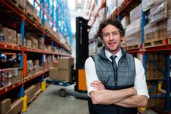 Warehouse manager front of forklift in warehouse Stock Photos