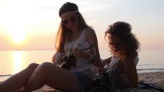 Beautiful Hippie Boho Styled Girls on Sunset Beach Stock Footage