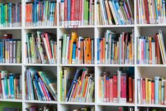 Front view of bookcase in library at school Stock Photos