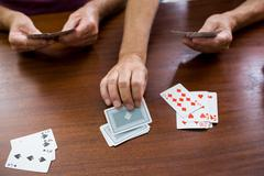 Two mans playing card in a retirement home Stock Photos