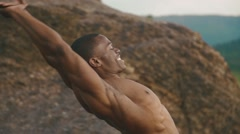 Close-up of african american bodybuilder with naked torso stretching outdoor Stock Footage