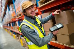 Warehouse worker using hand scanner in a warehouse Stock Photos