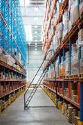 Front view of empty aisle in warehouse Stock Photos