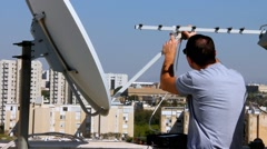 Installing of receiving device of satellite dish in the correct position Stock Footage
