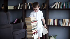 Children build a tower of books Stock Footage