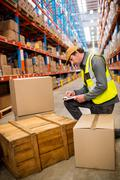 Man worker checking a pallet on the stairs in warehouse Stock Photos