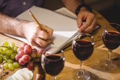 Close up view of mature man writing in a notebook  in his country house Stock Photos