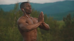 Muscular african american body builder with prayer hands stretching on the Stock Footage