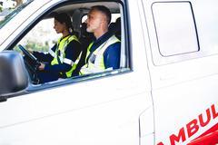 Portrait of ambulance men in ambulance car Kuvituskuvat
