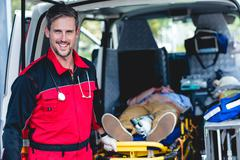 Portrait of ambulance man front of ambulance car Kuvituskuvat