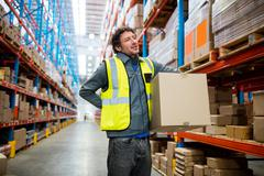 Worker Warehouse holding parcel in a warehouse Stock Photos