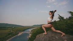Brunette woman fitness instructor with perfect muscular body stretching outdoor Stock Footage