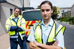 Portrait of ambulance crew front of ambulance car Kuvituskuvat