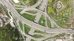 Aerial view of highway Road junction in a green city the rapid movement of car Stock Footage