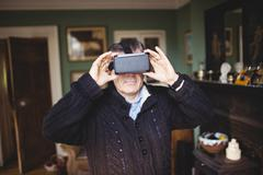 Portrait of casual man wearing smart glasses in country house Stock Photos
