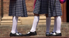 School Girls Wearing White Socks  Skirts - stock footage