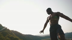 Silhouette of black african american handsome athlete man showing muscles on the Stock Footage