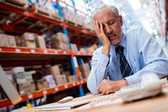 Anxious warehouse manager at office Stock Photos