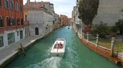 Venice, ITALY-CIRCA 2015 - Medium shot of boat along Venetian canal. Stock Footage