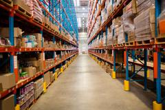 Wide warehouse aisle with no people Stock Photos