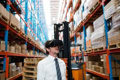 Warehouse manager using an oculus in warehouse Kuvituskuvat