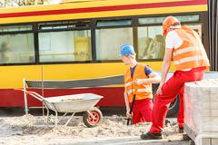 Road construction workers - stock photo