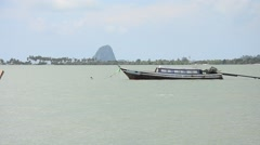 Wooden passenger boat ride a boats form Ko Yao Noi Harbour go to Koh Yao Yai Har Stock Footage