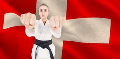 Female athlete practicing judo against digitally generated swiss national fla Kuvituskuvat