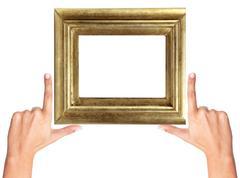 Finger frame and wooden golden frame isolated on white - stock photo
