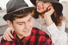 Smiled couple is spending free time in urban landscape - stock photo