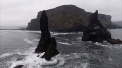 Ascension Shot Viewing Small Islands & Black Sand Beach in Vík í Mýrdal Iceland Stock Footage