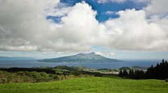 Timelapse of clouds passing over Mount Pico from Faial island, Azores, Portugal. Stock Footage