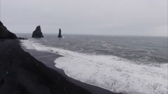 Flying Towards 2 Small Rocks From Black Sand Beach in Vík í Mýrdal Iceland Stock Footage