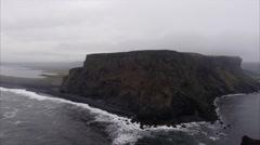 Panning Left View Island & Flying Towards Black Sand Beach in Vík í Mýrdal Icela Stock Footage