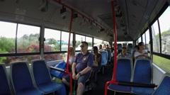 Passengers of  Bermuda public Breeze Bus. Stock Footage