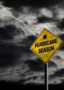 Vertical Hurricane Season Sign With Stormy Background - stock photo