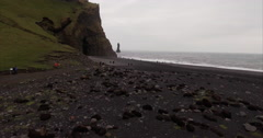 Speed Up Then Slow-mo Shot Of Black Sand Beach in Vík Iceland With Cave In Shot Stock Footage