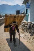 SAGARMATHA, NEPAL-APRIL 28: Porter on the hiking trail 28, 2016 in Sagarmatha - stock photo