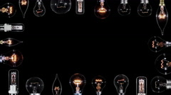 Many Edison lamps blinking over black, copyspace frame, looped Stock Footage