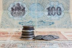 Old expired coins and banknotes. USSR coins and silver coins - stock photo