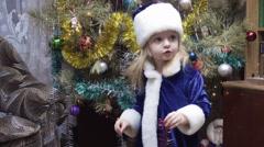 Maiden near Christmas tree - stock footage
