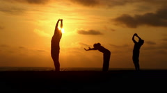 Yoga during sunset Stock Footage