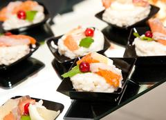 Finger food with smoked salmon - stock photo