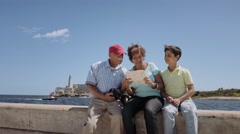 8-Family Grandparents Reading Tourist Map In Habana Cuba Stock Footage