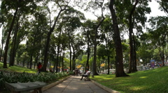 View of people chilling out in the park in the Ho Chi Minh City - stock footage