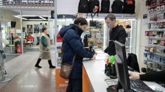 Moscow, Russia - February 18. 2016. The seller advises the buyer at store Stock Footage