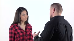 Conflicting couple quarrels and shouts isolated on white background. Slow motion Stock Footage