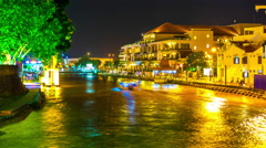Nightly view of the river and the skyline of Melakka - stock footage